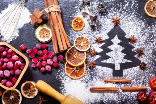 Christmas-cooking-fir-tree-made-from-flour-on-a-dark-table-ingredients-for-baking-frozen-cranberry-and-dried-fruits-on-dark-background-top-view.jpg